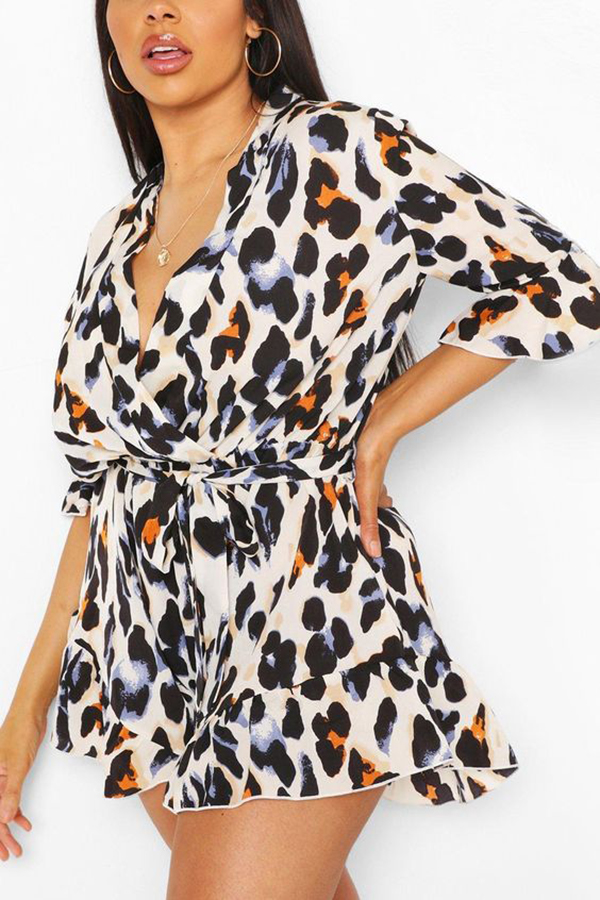 A plus-size model wearing an animal print romper.