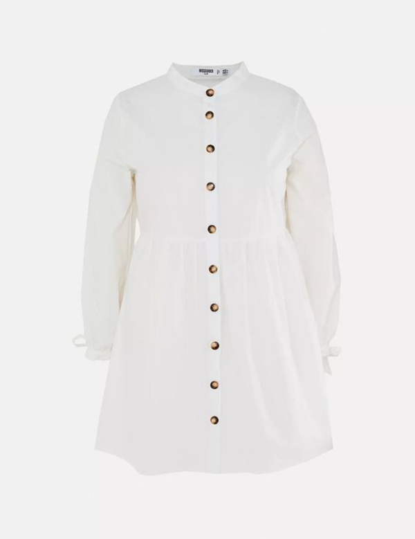 A plus-size button-up white shirtdress.