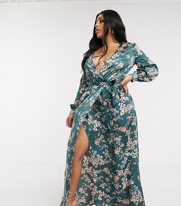 A plus-size model wearing a green floral maxi dress.
