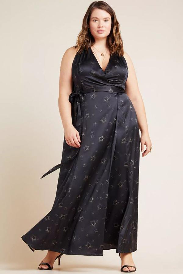 A plus-size model wearing a black halter dress.