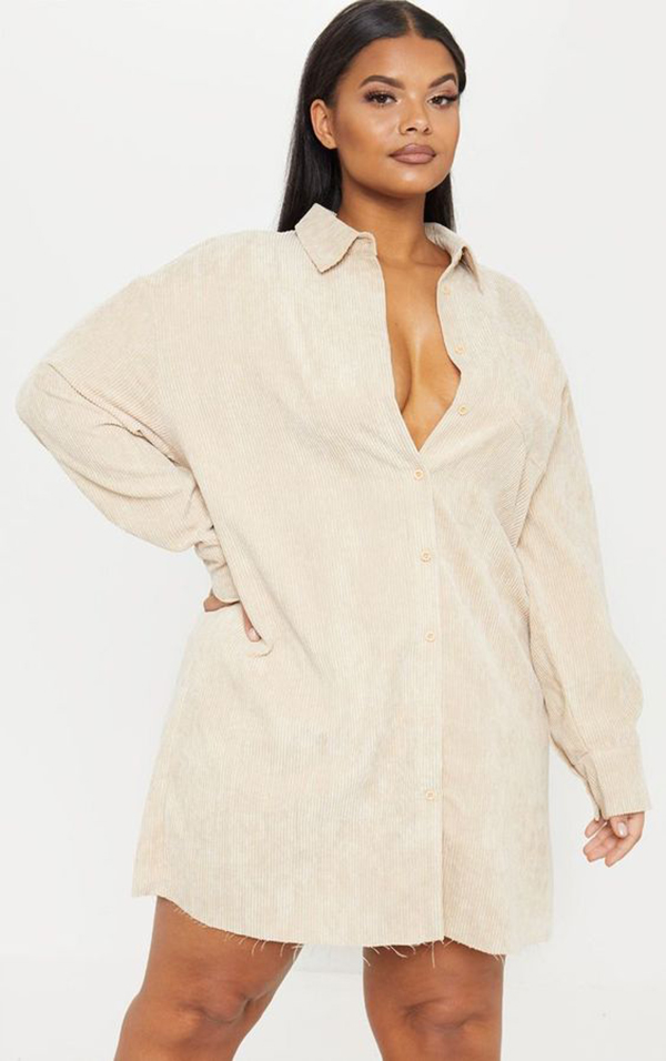 A plus-size model wearing a corduroy shirtdress.