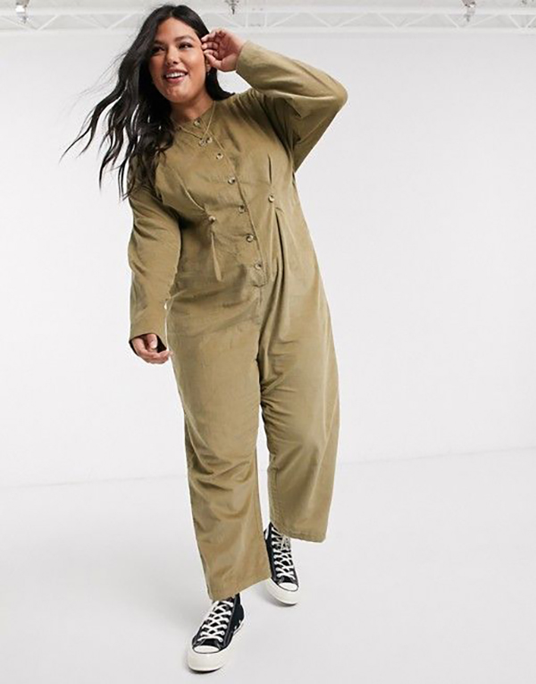 A plus-size model wearing a corduroy jumpsuit.