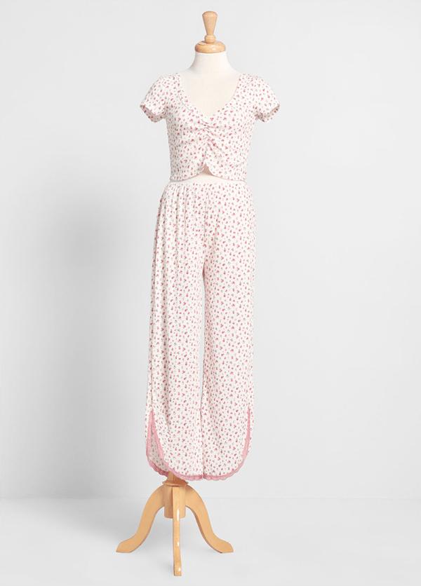 A plus-size pink floral pajama set.