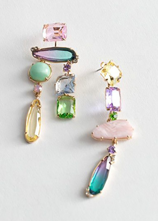 Asymmetrical statement earrings crafted from iridescent rhinestones