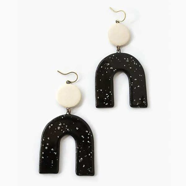 Black and white statement earrings shaped like upside-down Us