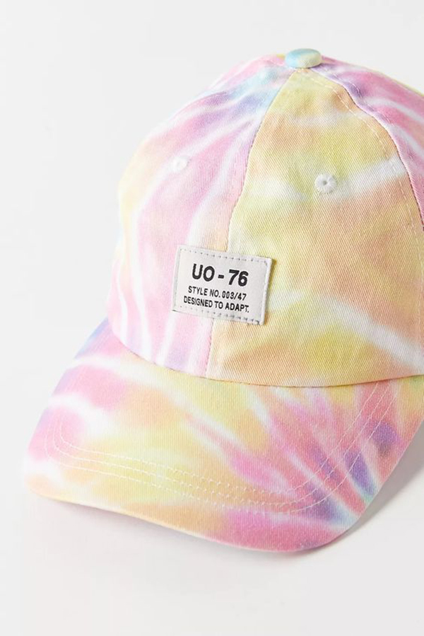 A pink and yellow tie-dye baseball cap.