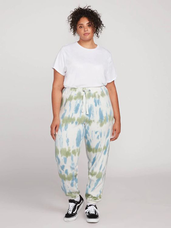A model wearing a pair of aqua tie-dye plus-size sweatpants.