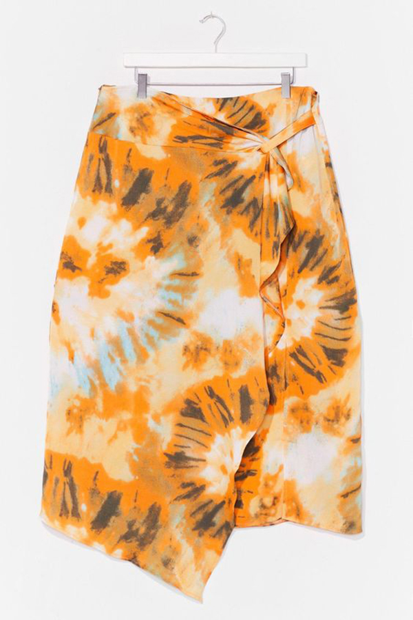 An orange plus-size tie-dye wrap skirt.