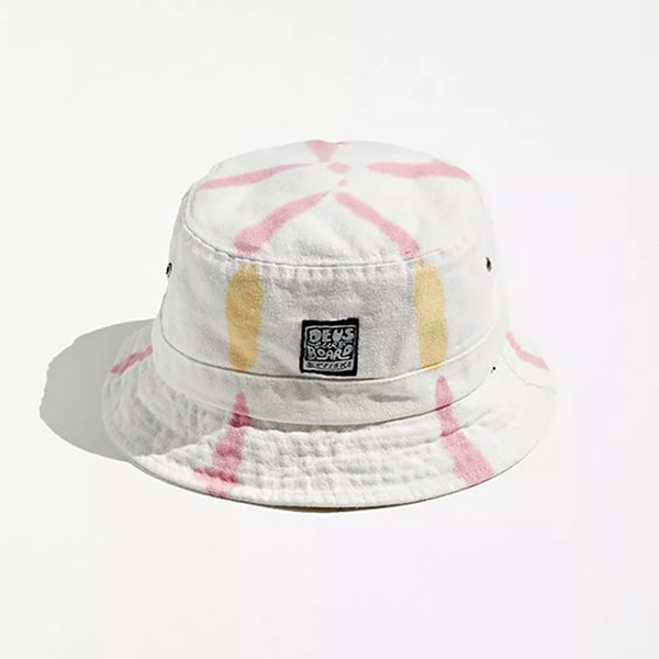 A white bucket hat with pink and yellow tie-dye stripes on it.