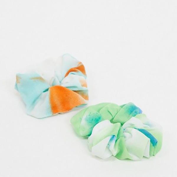 Two tie-dye scrunchies.