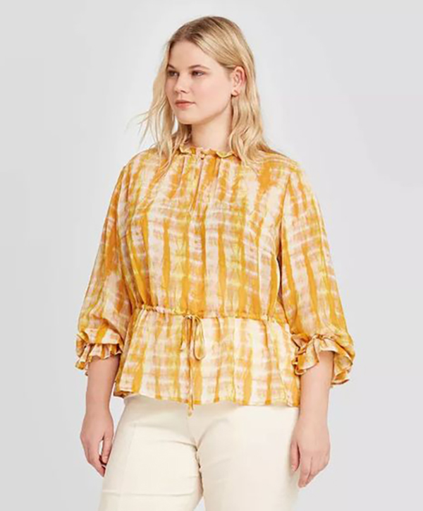 A model waring a yellow tie-dye plus-size top.