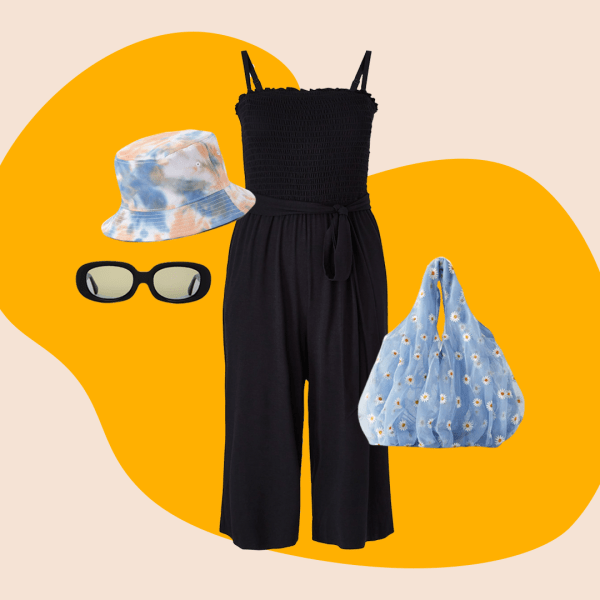black jumpsuit, tie-dye bucket hat, black sunglasses, and blue purse