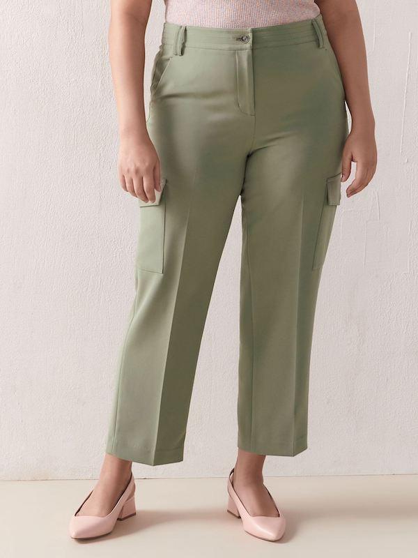 A woman wearing green pants.