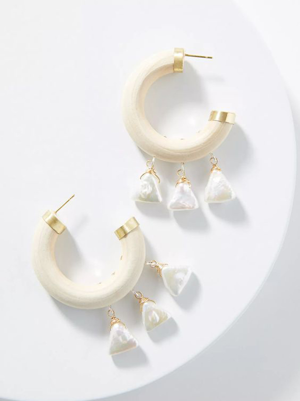 White hoop earrings with pearl tassels.