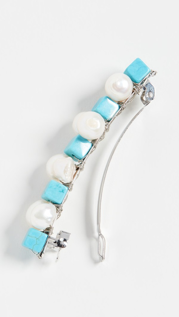 A barrette made of pearls and turquoise beads.
