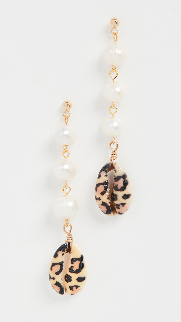 A pair of drop earrings made of pearls and leopard print-painted shells.