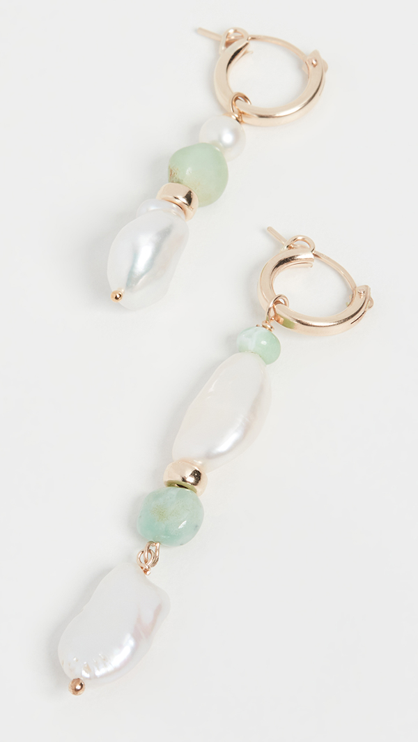 A pair of drop earrings crafted from light aqua beads and large pearls.