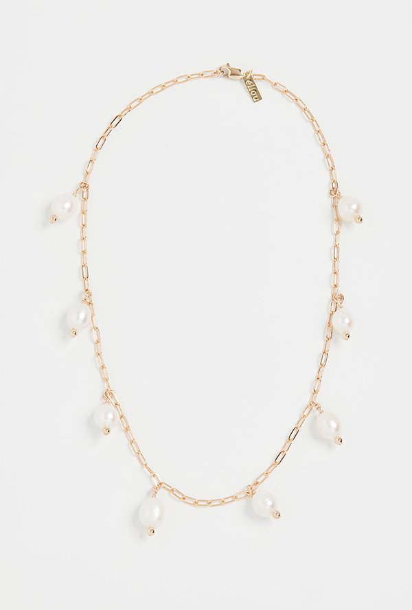 A gold chain necklace featuring several large pearls.