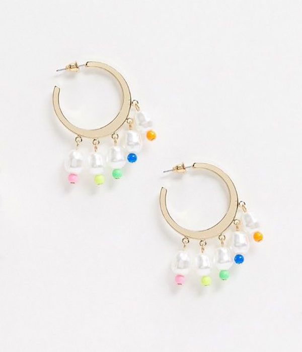 A pair of gold hoop earrings with pearls and rainbow beads dangling from them.