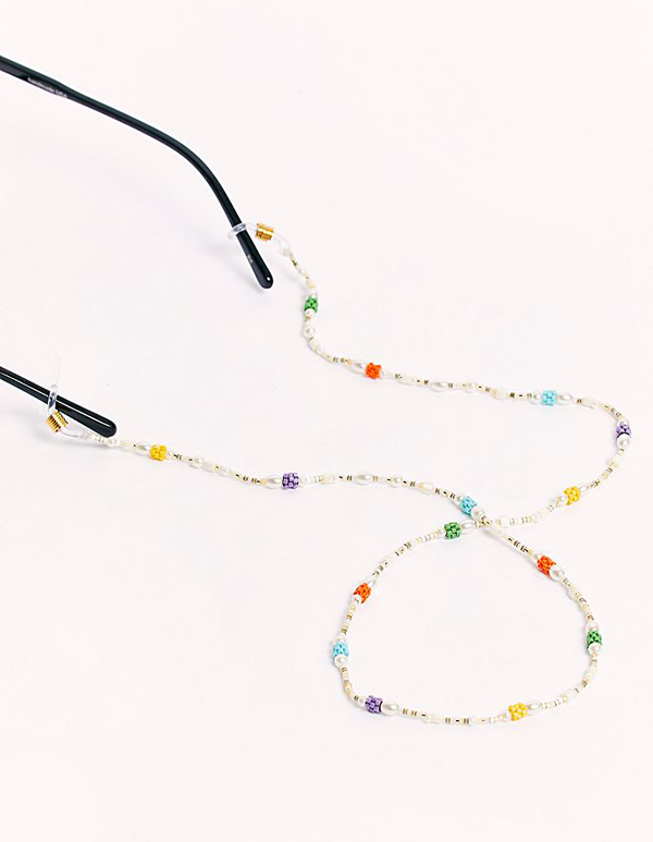 A pearl sunglasses chain with rainbow beads on it.