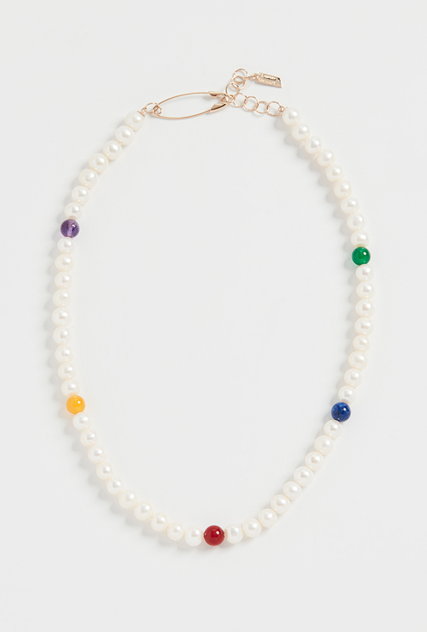A pearl necklace punctuated by rainbow beads.