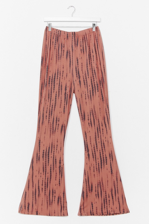 A pair of pink patterned flare pants.