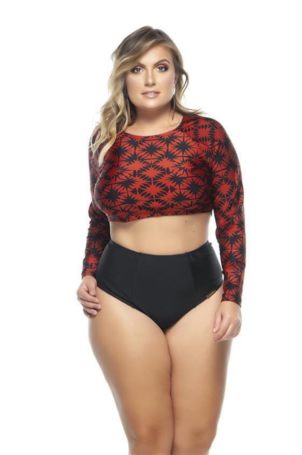A woman wearing a red and black long-sleeve bikini.