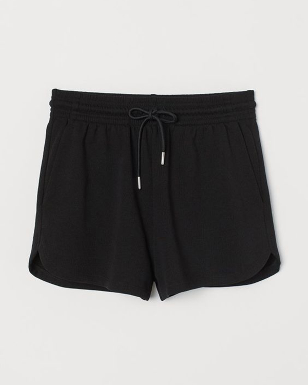 A pair of black plus-size sweat shorts.