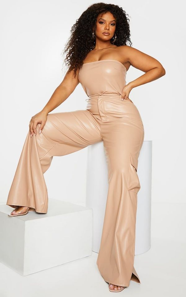 A model wearing a pair of plus-size cargo pants in tan.