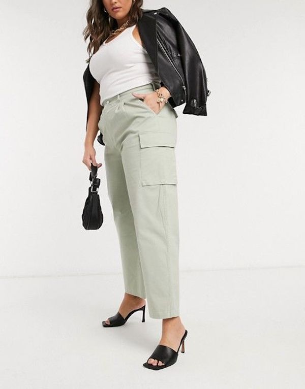 A model wearing a pair of plus-size cargo pants in mint green.