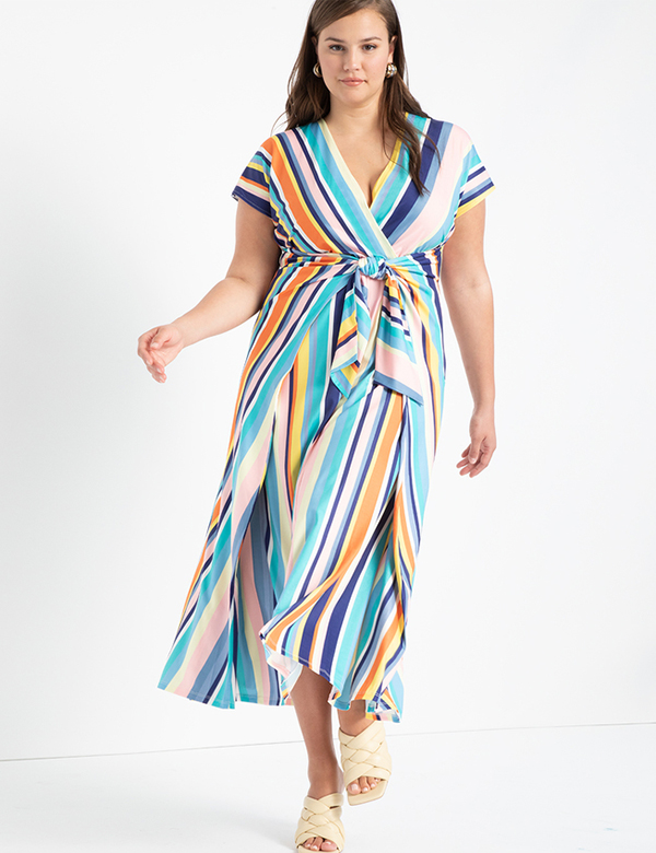 A plus-size model wearing a striped dress, which is now on sale at Eloquii for less than $39.