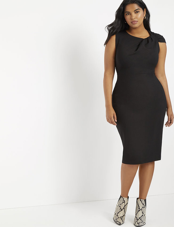 A plus-size model wearing a black cocktail dress, which is now on sale at Eloquii for less than $39.