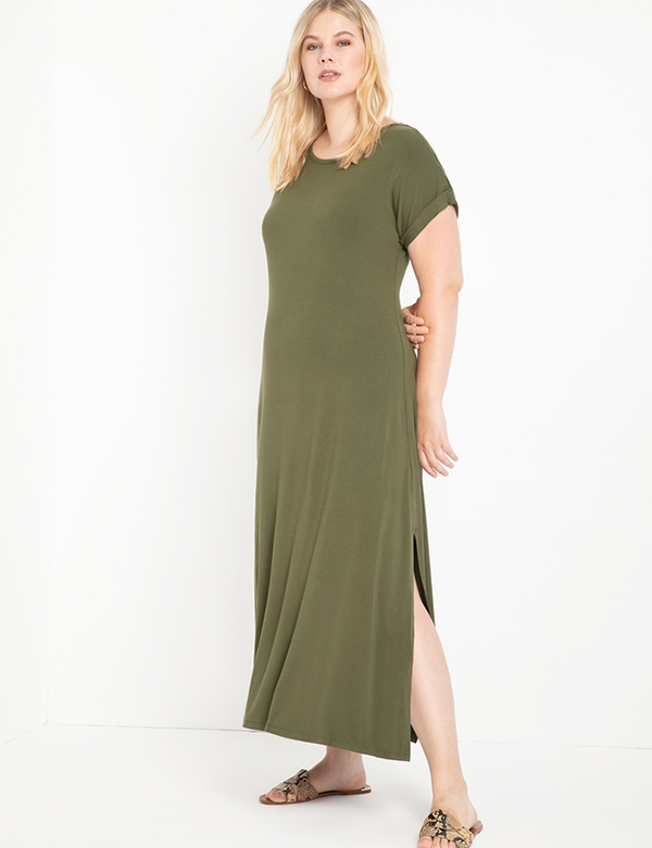 A plus-size model wearing an olive green T-shirt dress, which is now on sale at Eloquii for less than $39.