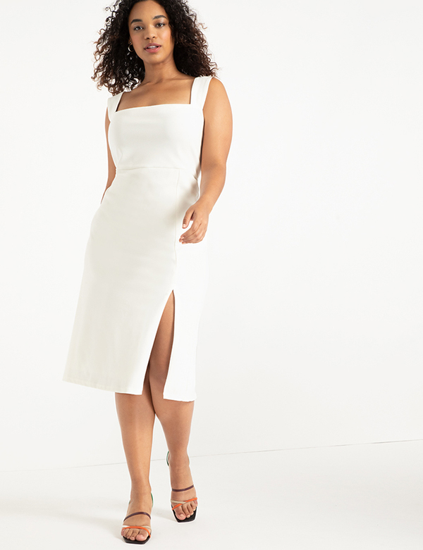 A plus-size model wearing a white dress, which is now on sale at Eloquii for less than $39.
