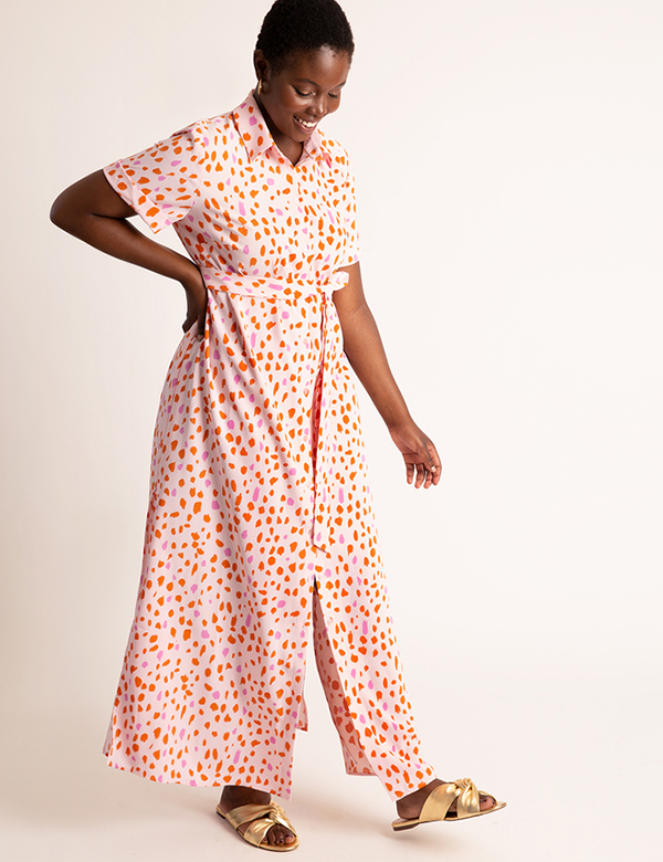 A plus-size model wearing a printed shirtdress, which is now on sale at Eloquii for less than $49.