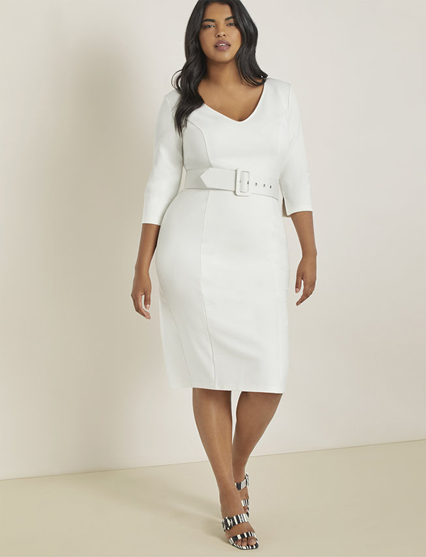 A plus-size model wearing a white workwear dress, which is now on sale at Eloquii for less than $49.