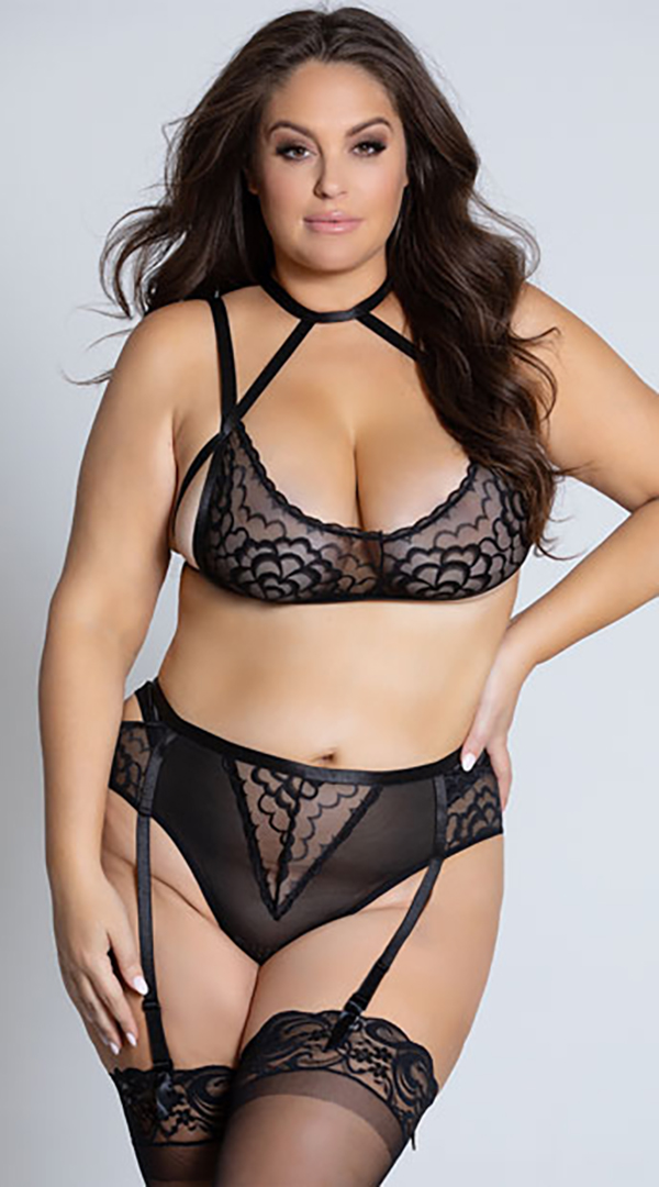 A plus-size model wearing a black lace lingerie two-piece, which is currently on sale at Yandy.