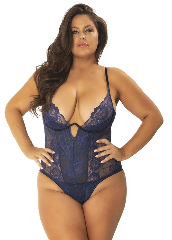 A plus-size model wearing a navy lace lingerie one-piece, which is currently on sale at Yandy.
