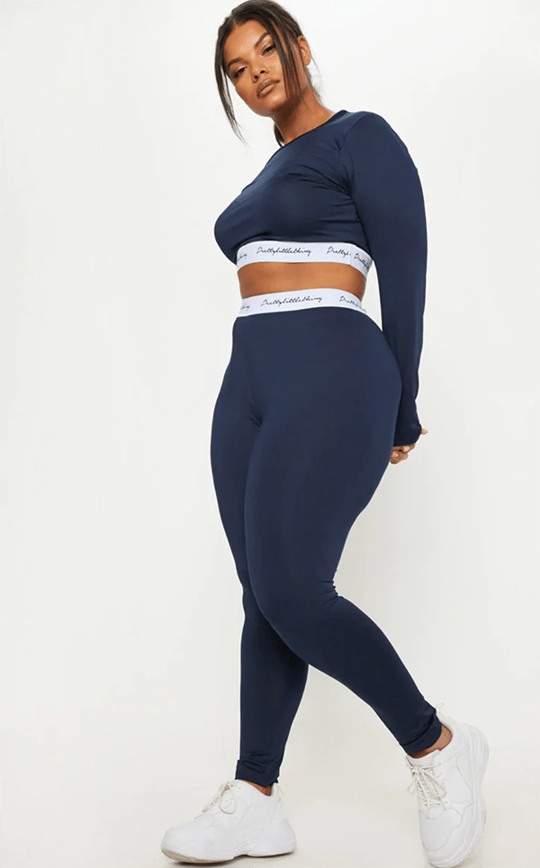 A plus-size model wearing a navy lounge set.