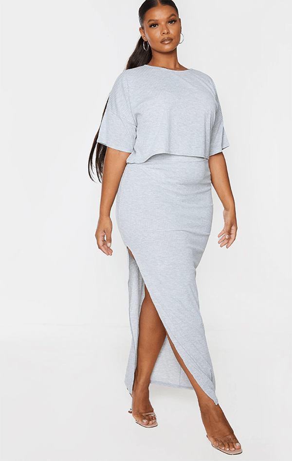 A plus-size model wearing a gray lounge set.