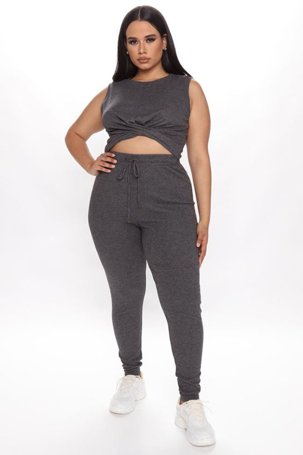 A plus-size model wearing a charcoal gray lounge set.