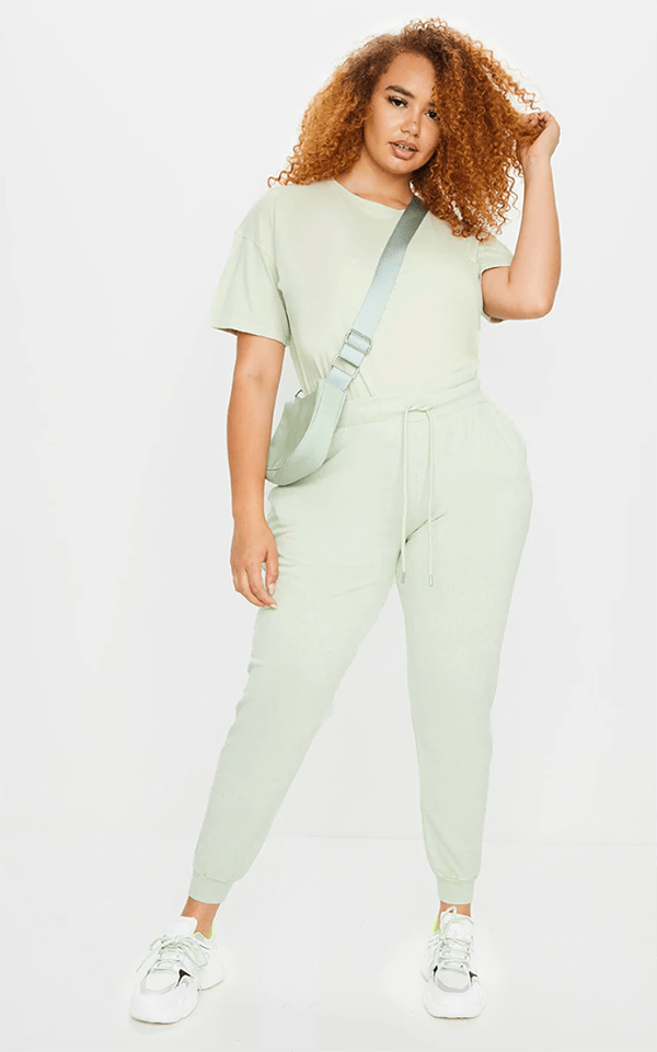 A plus-size model wearing a mint lounge set.