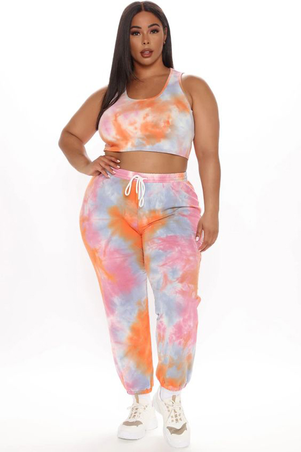 A plus-size model wearing a tie-dye lounge set.