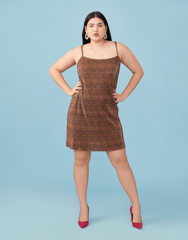 A plus-size model wearing a cheetah print mini dress.