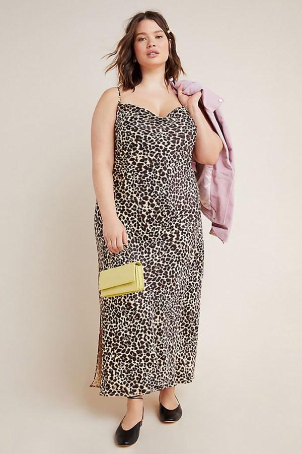 A plus-size model wearing a cheetah print slip dress.