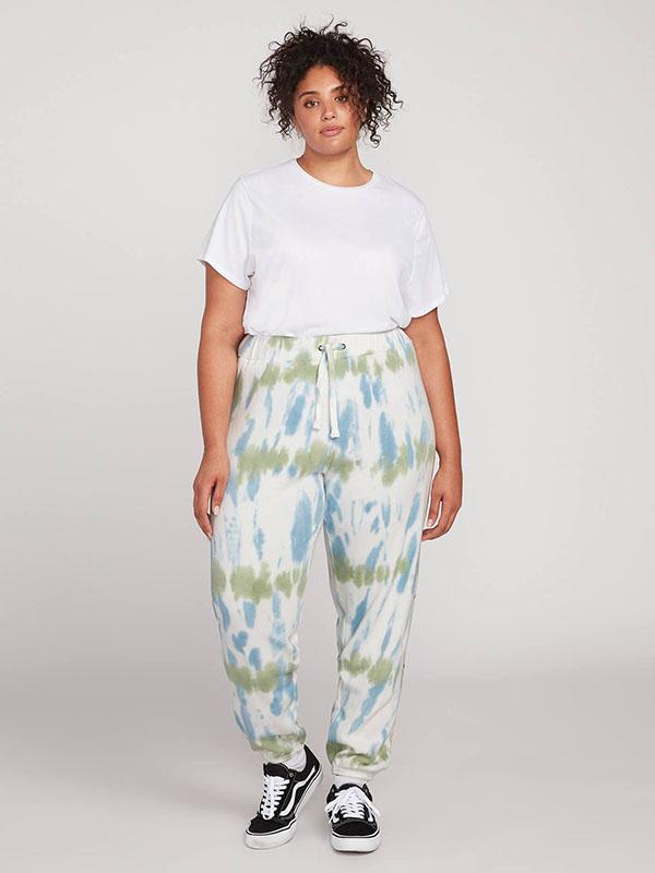 A plus-size model wearing a pair of aqua tie-dye sweatpants.