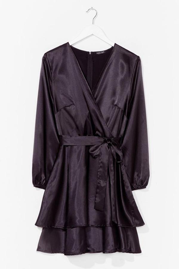 A plus-size black satin wrap dress.