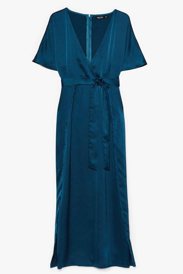 A plus size blue satin wrap dress.