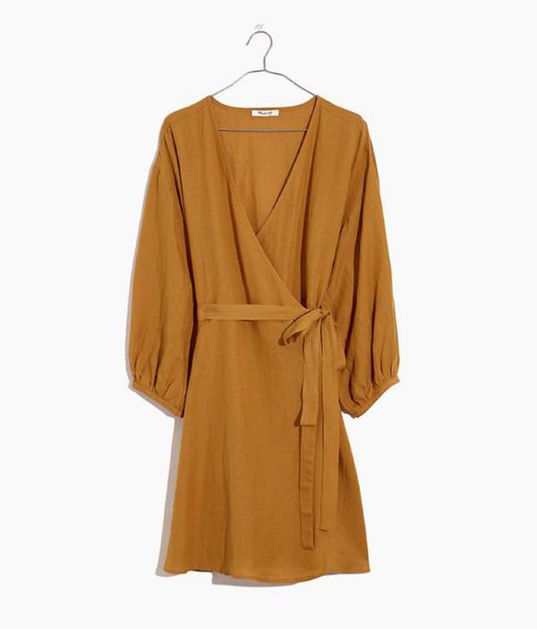 A plus-size brown wrap mini dress.