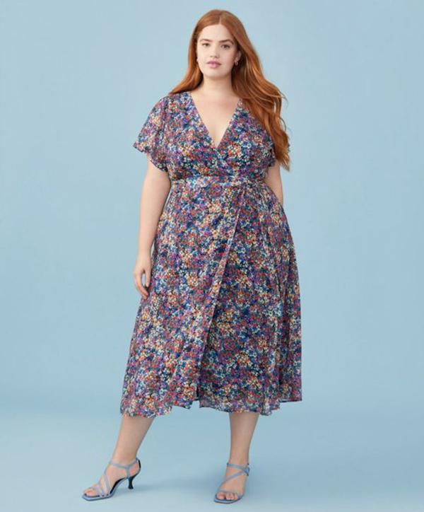 A plus-side model wearing a floral wrap dress.